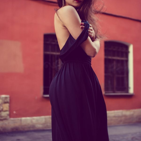 Woman in black dress women's disease in Vedas feminine health | The Sublime Woman
