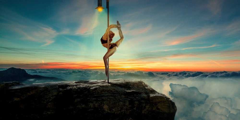 Beautiful sexy woman back-bending on the pole feminine exercise | The Sublime Woman