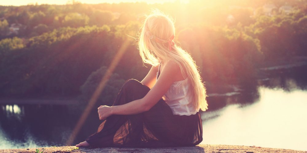 How to stop energy loss young woman sitting on the shore  The Sublime Woman