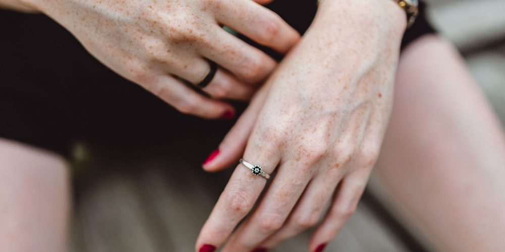 Woman's hands with red nail polish | The Sublime Woman
