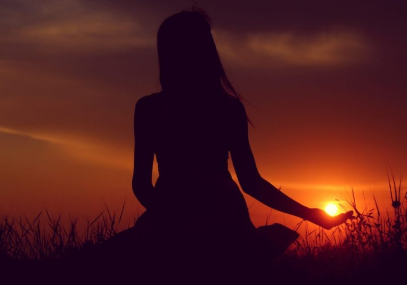Energy Sources For Woman woman sitting looking at sunset | The Sublime Woman