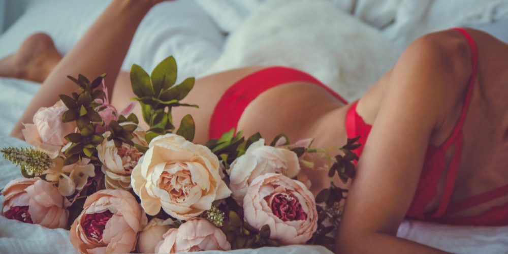 Magical Meditation For Women beautiful woman in lingerie in bed with flowers | The Sublime Woman