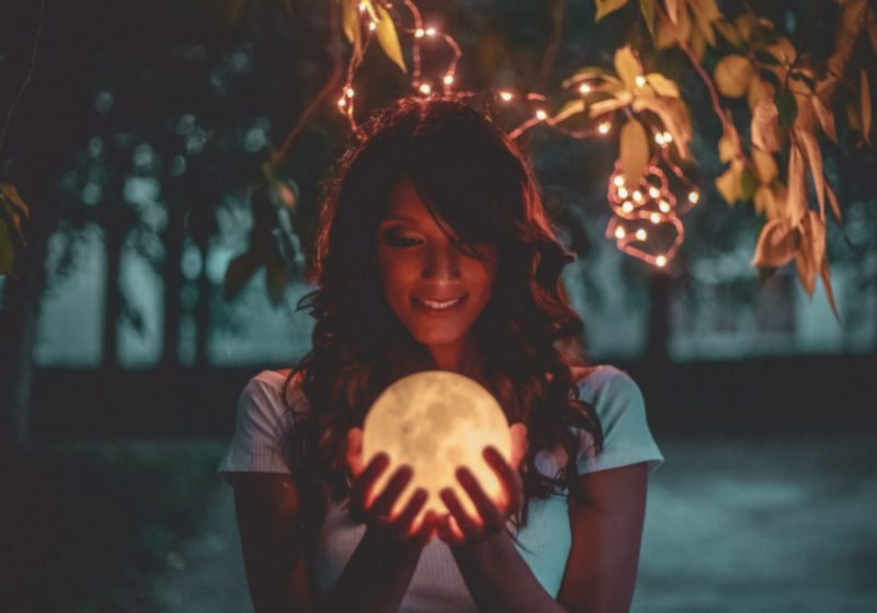 Vedic Astrology for Wise Women woman holding a moon | The Sublime Woman