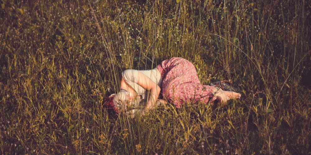 Feminine Rest Relaxing like a Woman beauiful woman laying in the field of flowers   The Sublime Woman