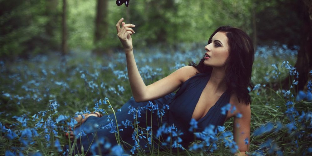 Practice: Woman's Ajna Chakra Healing beautiful woman in dark blue dress in forest and flowers   The Sublime Woman