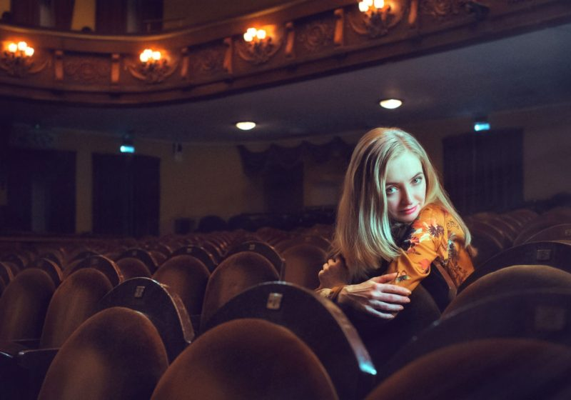 Movie and Chakras Beautiful blonde woman in a theater | The Sublime Woman