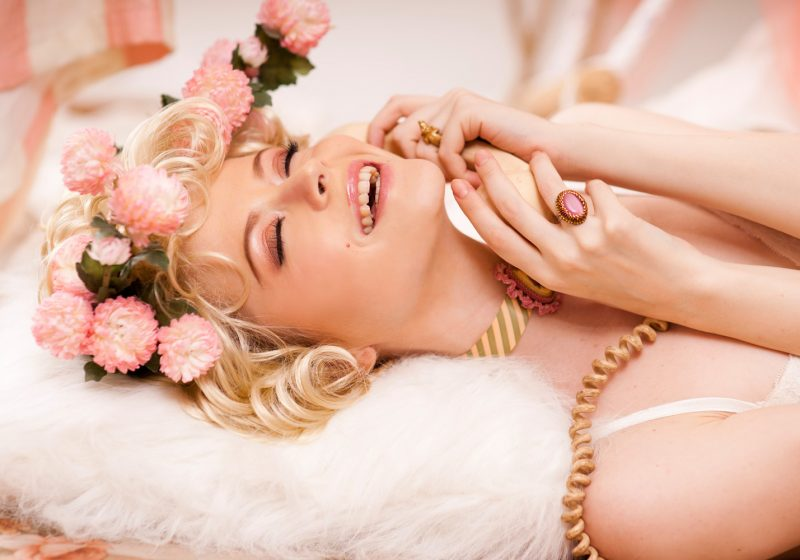 Happy Laughing Beautiful Woman With Flowers At Home, Hormones and Happinness, How Hormones Lead Help Us to be happy, The Sublime Woman